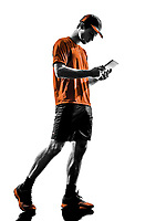 one young man runner jogger using digital tablets ipad in silhouette isolated on white background