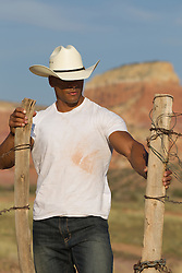 sexy and rugged African American Cowboy outdoors