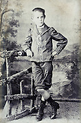 1900s boy posing in studio outdoors decor