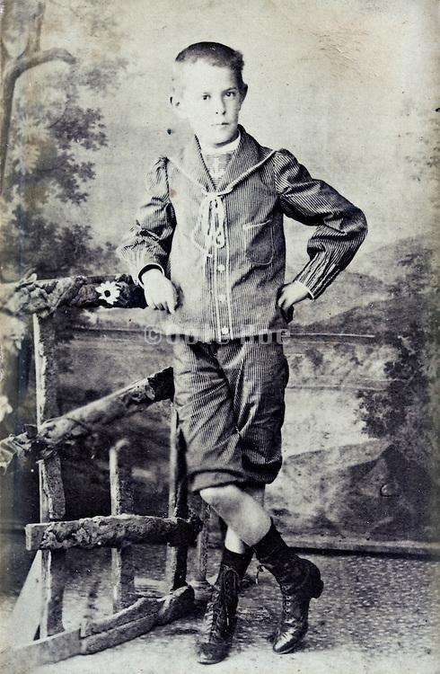 1900s boy posing in studio outdoors decor