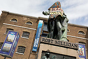 Hours before it was removed by the Canal and River Trust, the statue of merchant slave owner, Robert Milligan stands partially covered by Black Lives Matter activists outside the Museum of Londons Docklands Museum on the former quay of West India Docks, on 9th June 2020, in London, United Kingdom. Scottish merchant Robert Milligan 1746 - 1809 grew up on his familys sugar plantation in Jamaica and by the time of his death, owned 526 slaves of his own. Because of the theft of his sugar and rum cargoes from the docks of the day, he and other busnessmen built the massive West India Docks trade hub, him becoming Deputy Chairman of the West India Dock Company. In the aftermath of the George Floyd protests in the US and UK Black Lives Matter groups, who are calling for the removal of statues and street names with links to the slave trade, Milligans and other statues of British slavery owners and profiteers, have become a focus of impassioned protest.