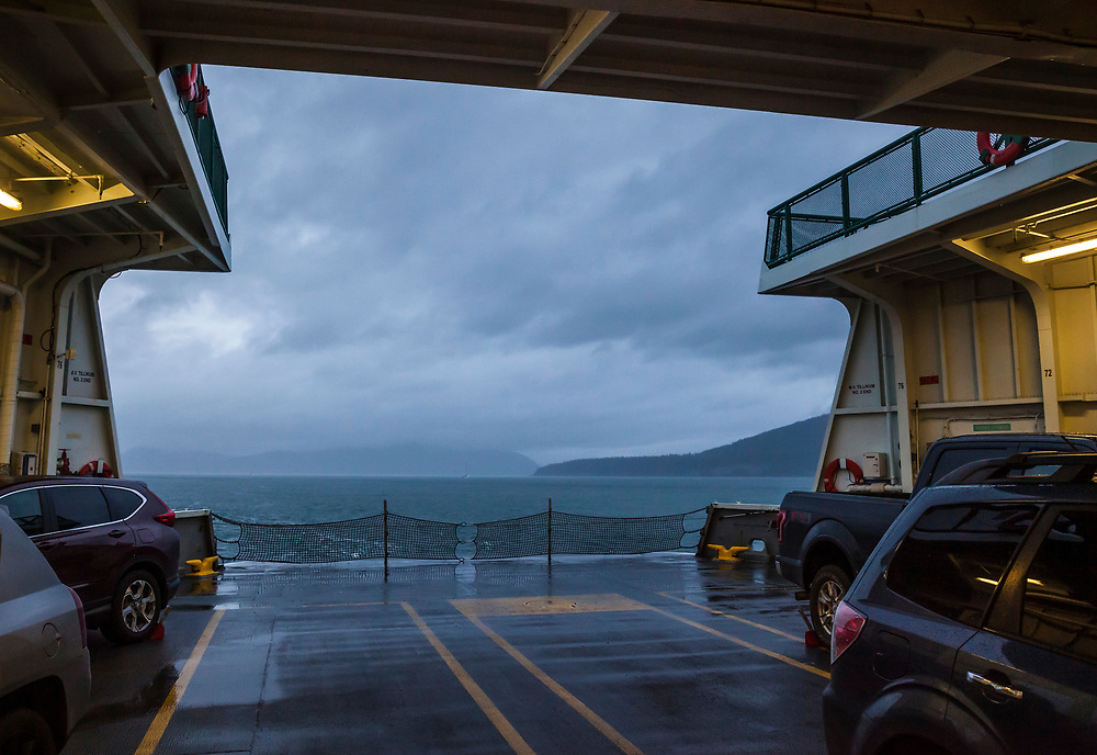 A Washington State Ferry under sail on a cloudy day in the San Juan Islands, Washington, USA.