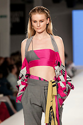 © Licensed to London News Pictures. 07/06/2016. London, UK. A model presents a look by Emma Peddle from Ravensbourne.  Graduate Fashion Week, day three, takes place at the Old Truman Brewery in East London.  The event showcases the work of over 1,000 of the very best graduates from over 40 universities around the world through 22 catwalk shows and more.  Photo credit : Stephen Chung/LNP