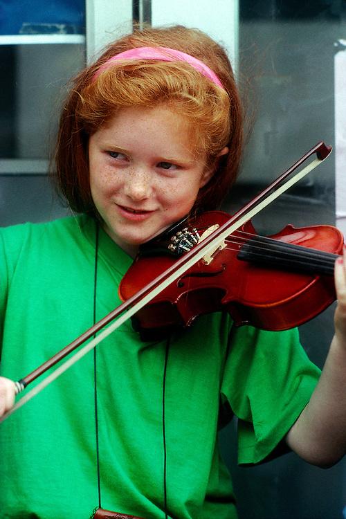 Irish girl playing violin on Grafton Street, Dublin, Ireland