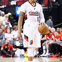 25 April 2016: Portland Trail Blazers guard Damian Lillard (0) brings the ball up court during the Portland Trail Blazers 98-84 victory over the Los Angeles Clippers, during Game Four of the Western Conference Quarterfinals of the NBA Playoffs at the Moda Center, Portland, Oregon, USA.