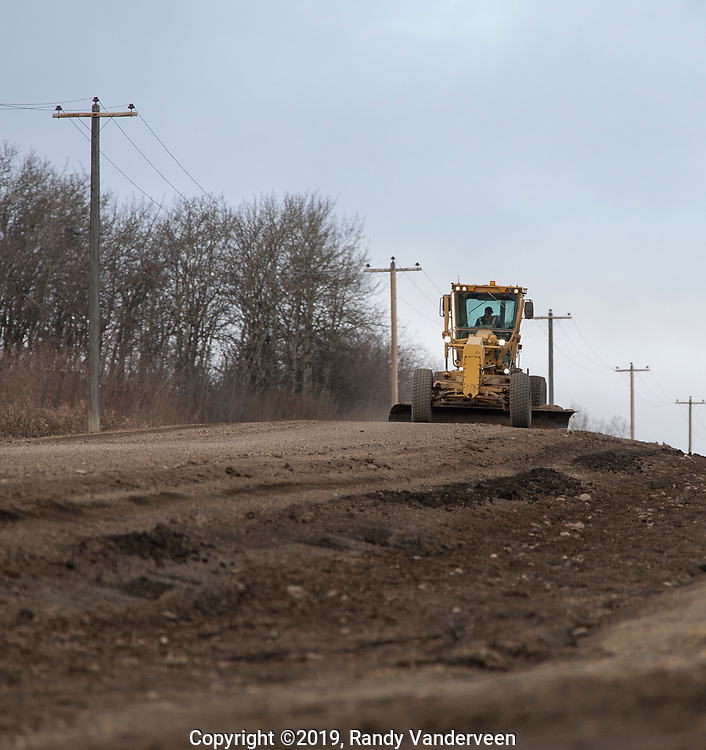 Photo Randy Vanderveen<br /> 2019-04-02<br /> Grande Prairie, Alberta<br /> A grader smooths out a county road northwest of Saskatoon Island Provincial Park Tuesday morning. With the frost starting to come up out of the ground roads are soft and are beginning to rut up in some areas.