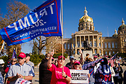 """07 NOVEMBER 2020 - DES MOINES, IOWA: Supporters of President Donald Trump at the Iowa State Capitol during a """"Stop the Steal"""" rally Saturday. They were protesting the ongoing efforts to count the votes in states like Arizona and Nevada. There were rival election rallies at the State Capitol in Des Moines Saturday. About 1,000 supporters of President Donald Trump gathered on the steps of the State Capitol and called for an end to vote counting. About 300 supporters of President Elect Joe Biden gathered in People's Plaza, on the south lawn of the Capitol, and called for the vote count to continue until every vote was counted.      PHOTO BY JACK KURTZ"""