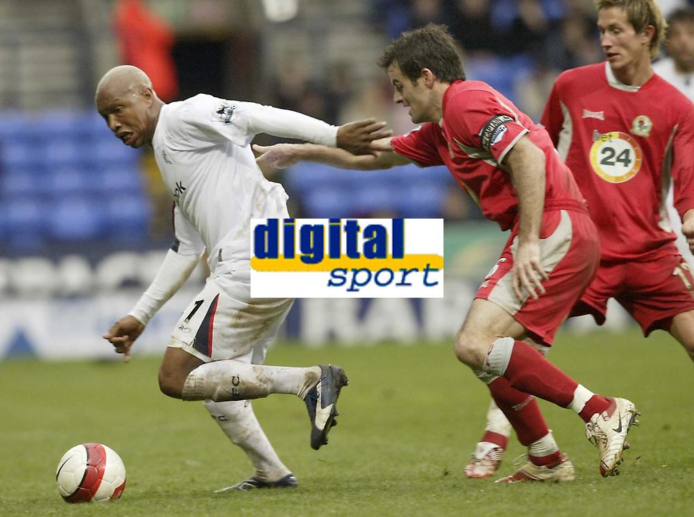 Photo: Aidan Ellis.<br /> Bolton Wanderers v Blackburn Rovers. The Barclays Premiership. 04/03/2007.<br /> Bolton's El Hadj Diouf (L) is watched closely by Blackburn's Ryan Nelsen
