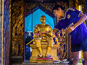 16 OCTOBER 2014 - BANGKOK, THAILAND: Boys clean a statue of King Chulalongkorn, also known as Rama V. Chulalongkorn was the fifth king of the Chakri dynasty and is one of the most revered Kings in Thai history. He is credited with leading the drive to modernize Thailand, then Siam, and keeping Siam independent when both British and French colonial authorities were pressing in on Siam.   PHOTO BY JACK KURTZ