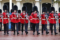 © Licensed to London News Pictures. 14/10/2019. London, UK. Scotts Guards line the route before Queen Elizabeth II rides the Diamond Jubilee Coach along The Mall to The Palace of Westmnster for the State Opening of Parliament. Photo credit: Peter Macdiarmid/LNP