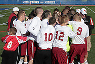 Middletown, New York - Fort Ann players and coaches huddle before taking on Chazy in the Class D state championship boys' soccer game at Faller Field in Middletown on Sunday, Nov. 18, 2012.