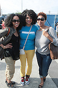"""June 2, 2012- Philadelphia, PA, United States: (L-R) Recording Artists Mercedes Martinez(Jazzyfatnastees), Marsha Ambrosius, and Tracy Moore(Jazzyfatnastees) attend the 5th Annual ROOTS Picnic held at Festival Pier at Penn's Landing in Philadelphia, PA . The Roots is an American hip hop/neo soul band formed in 1987 by Tariq """"Black Thought"""" Trotter and Ahmir """"Questlove"""" Thompson in Philadelphia, Pennsylvania. They are known for a jazzy, eclectic approach to hip hop which includes live instrumentals. (Photo by Terrence Jennings)"""