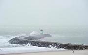 Pier in Scheveningen, The Hague during stormy weather.
