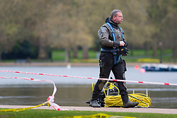© licensed to London News Pictures. London, UK 07/04/2014. Police divers getting ready as police officers searching the Serpentine in Hyde Park after a man in his 20s  feared drowned after taking a dip on Sunday afternoon of April 6, 2014. The lake has been cordoned off as the search continues on Monday, April 7, 2014. Photo credit: Tolga Akmen/LNP