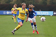 Everton forward Nicoline Sorensen (14) tussles with Brighton & Hove Albion defender Maya Le Tissier (6) during the FA Women's Super League match between Everton Women and Brighton and Hove Albion Women at the Select Security Stadium, Halton, United Kingdom on 18 October 2020.
