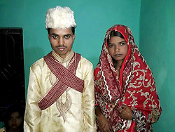 April 28, 2017 - JHARKHAND, INDIA - JHARKHAND, INDIA- APRIL, 26, 2017: New groom Mohammed Elias, 25, (left) and Rubana Parveen, 18, (right) pictured after getting married in Ranchi city in Jharkhand, India.....Muntaj Ansari, who got married to Rubana Parveen, 18, demanded a stylish motorbike after marriage and misbehaved with the bride's father. Rubana then divorced him and married Mohammed Elias on the same day. ....Pictures supplied by: Cover Asia Press (Credit Image: © Cover Asia Press/Cover Asia via ZUMA Press)