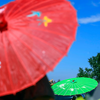Colorful umbrellas line come out under the sun during the Zuni Housing Authority Fair in Zuni Friday.