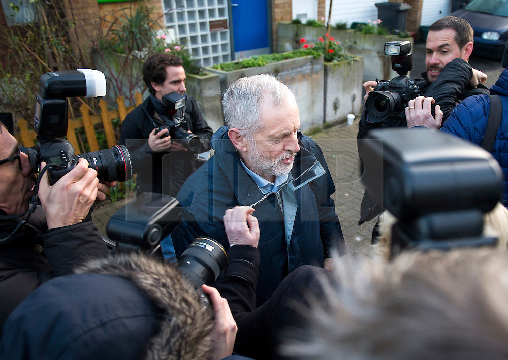 © Licensed to London News Pictures. 05/01/2016. London, UK. Labor party leader JEREMY CORBYN surrounded by media as he leaves his home in north London on the day he is expected to announce a shadow cabinet reshuffle. Photo credit: Ben Cawthra/LNP