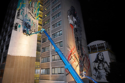 © Licensed to London News Pictures. 14/08/2012. Bristol, UK. Artists work at night next to some of last year's work in the See No Evil 2012 street art event, with artists from around the world creating new work on buildings in Nelson Street, Bristol.  It is the second year of the event and it will be the biggest permanent street art installation in Europe.  The project launches on 16 and runs till 19 August, with a Block Party on 18 August. 14 August 2012..Photo credit: Simon Chapman/LNP