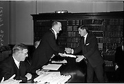 14/06/1963.06/14/1963.14 June 1963.Presentation of Admission Parchments at Solicitors building of the Four Courts Dublin. Patrick J. Connellan, Church Street, Longford, receives his admission parchment from Mr. Francis Lanigan, President of the Incorporated Law Society at the presentation of Admission Parchments in Dublin.