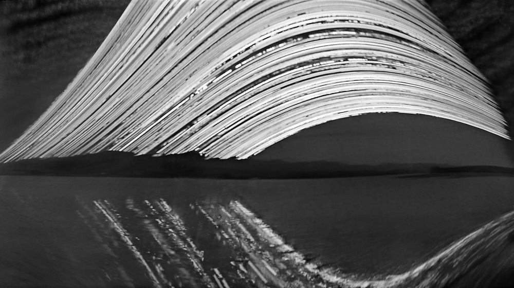 """Towards the Port Hills; Head of the Bay.<br /> 2016 (6 months pinhole exposure).<br /> 140mm x 250mm (image size).<br /> Pigment ink on paper.<br /> Editions of 5. First shown at the exhibition """"Art for Art"""" at the Christchurch Art Gallery Te Puna o Waiwhetū (2017)."""