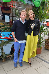 GUY & ELIZABETH PELLY at the launch of the new collection from Limoland held at Anderson & Sheppard's Haberdashery, 17 Clifford Street,London on 16th June 2014.