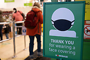 Face covering sign at the entrance to Homebase as the second national lockdown continues with just over a week before the new tier system begins, as all non-essential shops are closed while some remain trading on 21st November 2020 in Birmingham, United Kingdom. The new national lockdown is a huge blow to the economy and for individual businesses who were already struggling with only offering limited services.