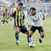 Besiktas's Manuel Fernandes and Fenerbahce's Selcuk Sahin during their Turkish Superleague SuperFinal Derby match Besiktas between Fenerbahce at the Inonu Stadium at Dolmabahce in Istanbul Turkey on Thursday, 03 May 2012. Photo by TURKPIX