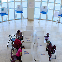 Voters fill out their ballots during early voting in the rotunda of the McKinley County Courthouse in Gallup Thursday.