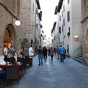 SAN GIMIGNANO, ITALY - OCTOBER 25: A street scene in San Gimignano, Italy. San Gimignano is an Italian hill town in Tuscany, southwest of Florence. Encircled by 13th-century walls, its old town centers on Piazza della Cisterna, a triangular square lined with medieval houses. It has a skyline of medieval towers, including the stone Torre Grossa. San Gimignano, Tuscany, Italy. 25th October 2017. Photo by Tim Clayton/Corbis via Getty Images)