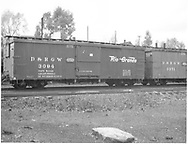 Side view of box car #3094 at Chama.  Coupled to box car #3371 (partially seen).<br /> D&RGW  Chama, NM  1939