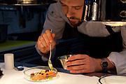 Mirko Gaul, chef at Taku restaurant, smoking trout in the kitchen. Hotel Excelsior Hotel Ernst, Cologne.