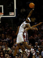 LeBron James goes up for a slam dunk against Phoenix.