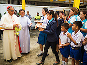 18 SEPTEMBER 2016 - BANGKOK, THAILAND:  FRANCIS XAVIER KRIENGSAK, (left) the Archbishop of Bangkok, greets parishioners at Santa Cruz Church before leading the church's 100th anniversary mass. Santa Cruz Church was establised in 1769 to serve Portuguese soldiers in the employ of King Taksin, who reestablished the Siamese (Thai) empire after the Burmese sacked the ancient Siamese capital of Ayutthaya. The church was one of the first Catholic churches in Bangkok and is one of the most historic Catholic churches in Thailand. The first sanctuary was a simple wood and thatch structure and burned down in the 1800s. The church is in its third sanctuary and was designed in a Renaissance / Neo-Classical style. It was consecrated in September, 1916. The church, located on the Chao Phraya River, serves as a landmark for central Bangkok.      PHOTO BY JACK KURTZ