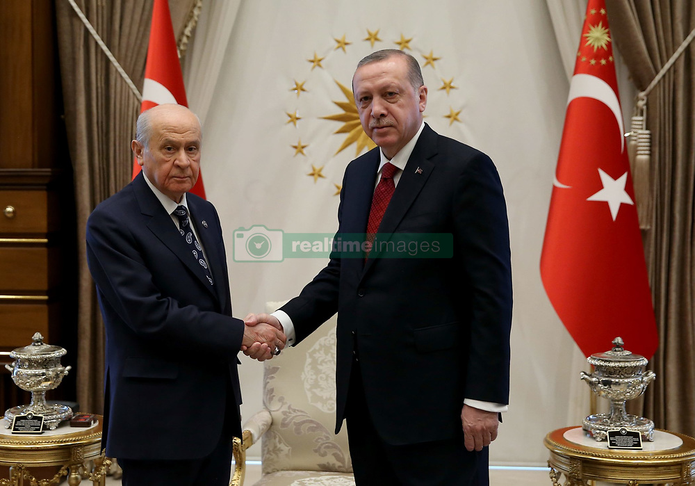 April 18, 2018 - Ankara, Türkiye - Turkey's President Recep Tayyip Erdogan has announced a decision to hold snap elections in June 24 this year after he met the leader of the country's opposition Nationalist Movement Party (MHP), Devlet Bahceli, at the presidential complex on Wednesday. The president's decision comes a day after Bahceli called for early presidential and parliamentary elections. (Credit Image: © Depo Photos via ZUMA Wire)