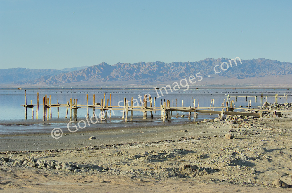 Old docks still used by duck hunters.<br /> <br /> The Salton Sea continues to shrink due to evaporation. The water which is left is ever more saline.