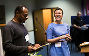 MILWAUKEE, WI – MARCH 28: Zeidler Center Executive Director, Dr. Katherine Wilson, right, laughs as discussion facilitator Olu Sijuwade, left, introduces the Harambee neighborhood Police and Resident Discussion event at Grace Fellowship Church on Monday, March 28, 2016.