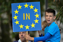 © Licensed to London News Pictures. 09/09/2017. London, UK. A young Anti-Brexit protester holds up a sign in Parliament Square during the People's March for Europe rally campaigning for the UK's continued membership of the European Union. Photo credit : Stephen Chung/LNP