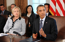 US President Barack Obama speaks at a Cabinet Meeting as Secretary of State Hillary Clinton looks on in the Cabinet Room at the White House in Washington, DC, USA, on October 3, 2011. Photo by Olivier Douliery/ABACAPRESS.COM