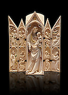 Medieval Gothic ivory tabernacle depicting the Virgin and Child with scenes from the Annunciation, Nativity, the adoration of the Magi and the presentation at the Temple  made in Paris in second quarter of the 14th century and is a typical example of tabernacles made in Paris at that period.  inv 2587, The Louvre Museum, Paris.  .<br /> <br /> If you prefer you can also buy from our ALAMY PHOTO LIBRARY  Collection visit : https://www.alamy.com/portfolio/paul-williams-funkystock/gothic-art-antiquities.html  Type -   louvre     - into the LOWER SEARCH WITHIN GALLERY box. Refine search by adding background colour, place, museum etc<br /> <br /> Visit our MEDIEVAL ART PHOTO COLLECTIONS for more   photos  to download or buy as prints https://funkystock.photoshelter.com/gallery-collection/Medieval-Gothic-Art-Antiquities-Historic-Sites-Pictures-Images-of/C0000gZ8POl_DCqE