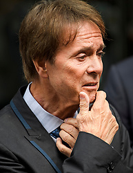 © Licensed to London News Pictures. 18/07/2018. London, UK. An emotional SIR CLIFF RICHARD gestures as he leaves the Rolls Building of the High Court in London where judges ruled in favour of a claim by Sir Cliff Richard for damages against the BBC for loss of earnings. The 77-year-old singer sued the corporation after his home in Sunningdale, Berkshire was raided following allegations of sexual assault made to Metropolitan Police. Photo credit: Ben Cawthra/LNP