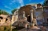 The Serapaeum, dedicated to the gods Isis and Serpis which was probably used as a banqueting hall. Hadrian's Villa ( Villa Adriana ) built during the second and third decades of the 2nd century AD, Tivoli, Italy. A UNESCO World Heritage Site. .<br /> <br /> If you prefer to buy from our ALAMY PHOTO LIBRARY  Collection visit : https://www.alamy.com/portfolio/paul-williams-funkystock/hadrians-villa-tivoli.html<br /> Visit our CLASSICAL WORLD HISTORIC SITES PHOTO COLLECTIONS for more photos to buy as buy as wall art prints https://funkystock.photoshelter.com/gallery-collection/Classical-Era-Historic-Sites-Archaeological-Sites-Pictures-Images/C0000g4bSGiDL9rw