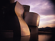 An exterior shot of the architecture of the Guggenheim Museum in Bilbao, Spain