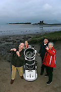 """26-1-2014: Julie Ormonde of the Kerry Dark Sky group pictured on Ballinskelligs Beach observing the sky with local astronomers Michael Sheehan, Dessy Cronin and Michael Lyne  at the weekend.<br /> Picture by Don MacMonagle<br /> Story by Majella O""""Sullivan"""
