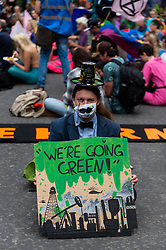 """© Licensed to London News Pictures. 03/09/2021. LONDON, UK.  A costumed climate activist from Extinction Rebellion during a protest outside the Lloyds Building in the City of London to highlight the complicity of the financial industry on climate change.  The event takes place on day twelve of the two week 'Impossible Rebellion' protest to """"target the root cause of the climate and ecological crisis"""".  Photo credit: Stephen Chung/LNP"""