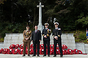 British Ambassador, Paul Madden (second from left) poses with army and navy officers at the Cross of Sacrifice during the  Remembrance Sunday ceremony at the Hodogaya, Commonwealth War Graves Cemetery in Hodogaya, Yokohama, Kanagawa, Japan. Sunday November 12th 2017. The Hodagaya Cemetery holds the remains of more than 1500 servicemen and women, from the Commonwealth but also from Holland and the United States, who died as prisoners of war or during the Allied occupation of Japan. Each year officials from the British and Commonwealth embassies, the British Legion and the British Chamber of Commerce honour the dead at a ceremony in this beautiful cemetery.