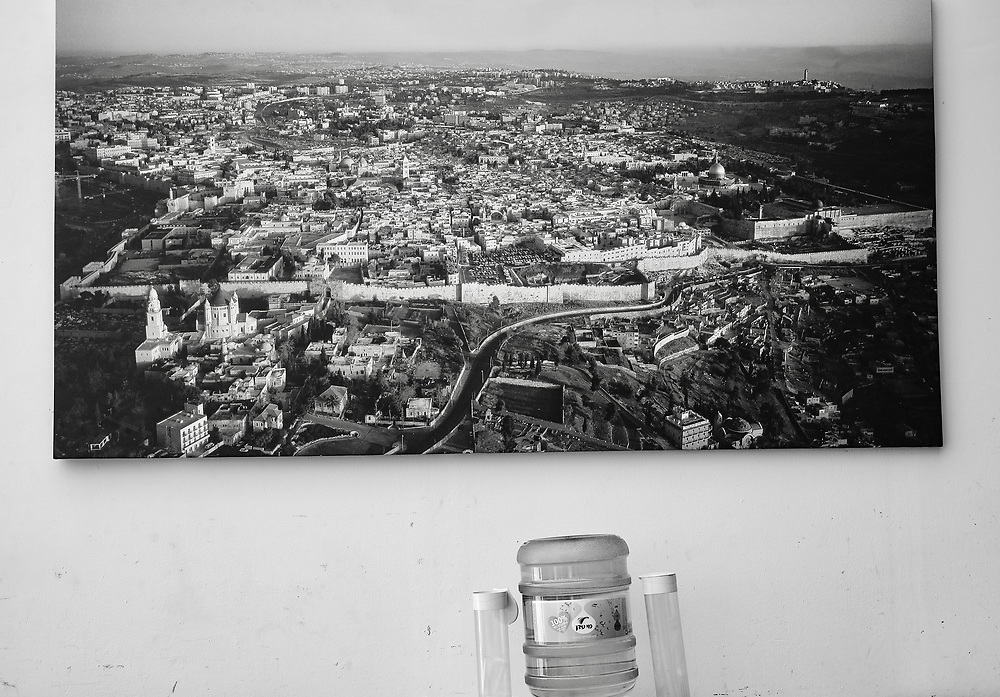 A photograph hangs over a water cooler in Jerusalem, Israel.