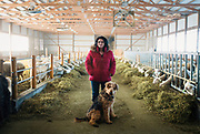 WESTBY, WI — DECEMBER 9: Brenda Jensen, owner of Hidden Springs Creamery, and her dog Gus pose for a portrait in the main sheep barn. Jensen and Hidden Springs Creamery have won numerous National and International awards for their aged sheep cheeses.