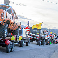A line of cars and trucks parade into Tohatchi during the Tohatchi High School Homecoming parade in Tohatchi Wednesday.
