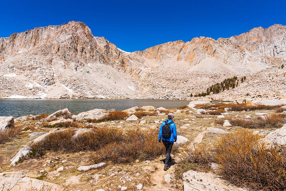 Hiker exploring Cottonwood Lake #5 under Mount Langley, John Muir Wilderness, California USA